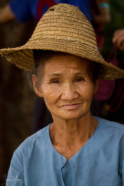 Old Chinese Woman with Straw Hat