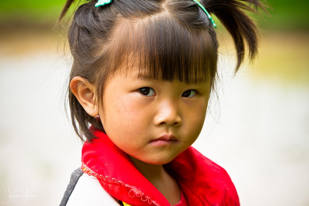 Five year old kid at the rice paddies of Yangshuo, China
