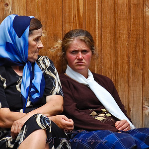 Two women waiting for the bus, Sihastria, Romania.
