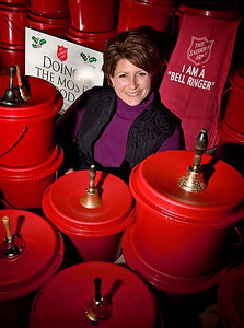 Sandy Steffes, development director at the Salvation Army in Sheboygan, is pictured on Tuesday, Nov. 6, 2007, with some of the many kettles that will soon be deployed to 15 Sheboygan area locations as part of the annual kettle drive. Press photo/Sam Castro