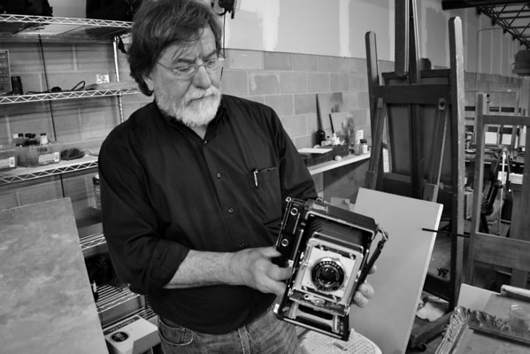 """Ken"" - demonstrating some of his classic cameras."