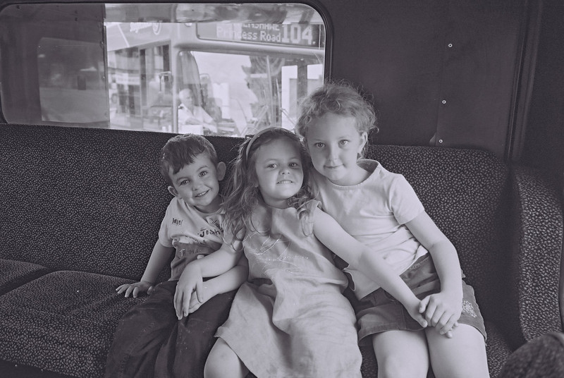 sam, ellie + rachael, back seat of the 86 bus, manchester 2003