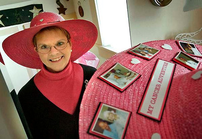 Joanne D'Alton, reflected in a mirror in her Sheboygan home, models her Pink Brigade hat  on Thursday, Oct. 23, 2008. Photo by Sam Castro/The Sheboygan Press