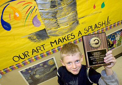Ben Johns, 8, a second-grader at Sheridan Elementary in Sheboygan, won first place in the Wisconsin State Reading Association's billboard contest. A drawing he created will be used as a poster for the association. Press photo/Sam Castro