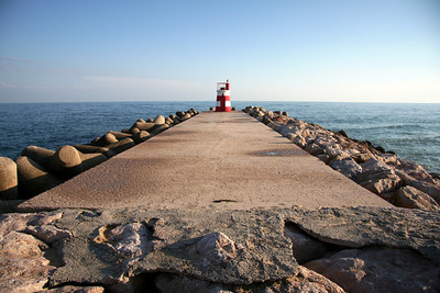 Lighthouse on sea wall - Ilha de Tavira