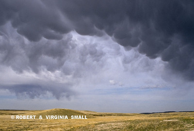 MAMMATUS CLOUDS WITH STORM OVER PRAIRIE