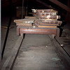 Ledgers and journals sitting on a wood tracked trolley, dating back to the early 1900's. Many more records were located at the other end of these tracks.