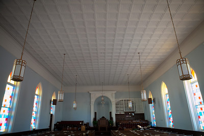 The ceiling is of tin panels.
