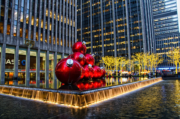 Oversized red Christmas ornaments on 6th Ave