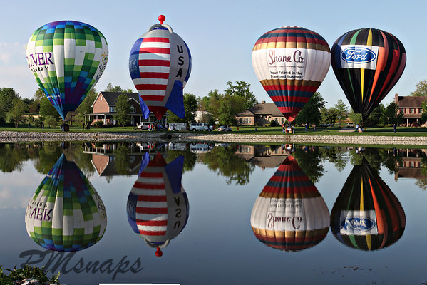 Project 365-120<br /> <br /> Picture Perfect!  The Kentucky Derby Festival Great Balloon Race had quite a fantastic day to fly.  After dropping the streamer for the competition, I happened to be in the right place at the right time for these 4 balloons that lined up on the other side of this pond.  There was a 5th balloon, but I caught that separately.