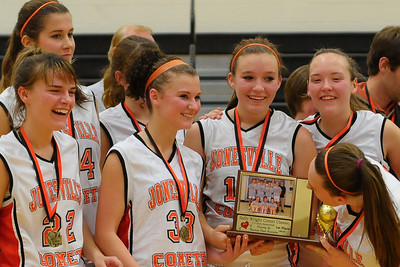 "12/2/10 - ""Hey my picture is on that trophy!""  The JV Girls Basketball team celebrates their tournament victory tonight."