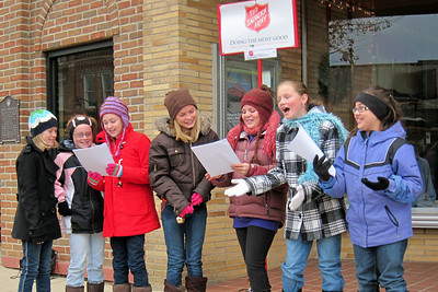12/4/10 - This afternoon seven 5th grade friends assembled to help the Salvation Army by singing Christmas Carols at one of the kettles in town.