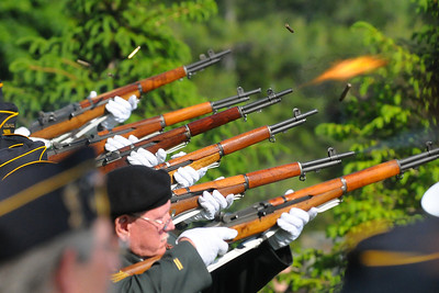 Week 22 - The local American Legion Post fires off a 21 gun salute during the closing of the Memorial Day ceremony.