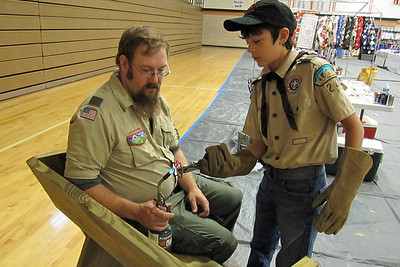 Week 32 - During the Lions Craft Show.  Pictured are some members of the Boy Scout troop putting the final touches on one of their benches they were selling.