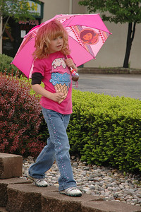 Week 22 - This young lady was out for a Sunday morning strole with her Father.  It wasn't raining but she was prepared never the less.