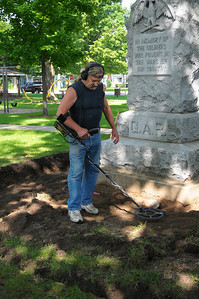 Week 32 - As construction began on a Civil War Monument in the Village park this man took advantage of the opportunity to look for old coins.