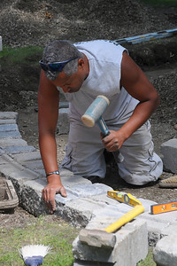 Week 32 - Adjusting the first course of blocks in the Civil War Monument.