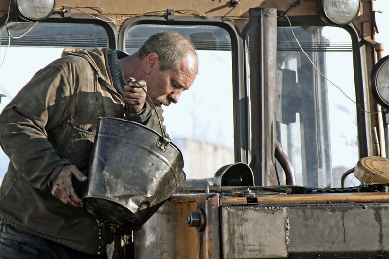 Adding oil or maybe antifreeze. (Udokan, Russia) (4.14.2011)