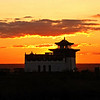 Buddhist Temple sunset on the Kalmykian steppe. Part of Russia, the Republic of Kalmykia is the only Buddhist state in Europe. <br /> <br /> Another from the archives as things are quite stressful here in anticipation of my upcoming hand surgery. One would think things would be all set 3 days before surgery, but this is Russia & the amount of B.S. one has to deal with is overwhelming. Won't bore you with the details, which most people would be shocked by, but it's now Saturday afternoon & things are so bad I'm not sure if it'll be a go Monday A.M. Truth be told, I'm somewhat distraught.<br /> <br /> Sorry for recycling & the small number of comments I posted yesterday & today. Hubby Rustem's due back in Moscow in a few hours after 11 days in deep Siberia, so may have something new to post tomorrow. Thanks to all for your support. Have a good weekend. (4.2.2011)