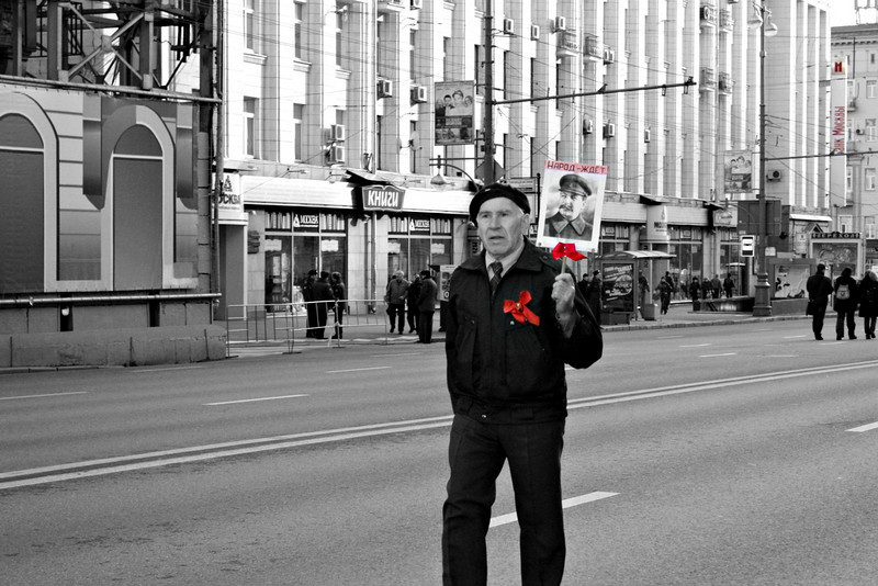 "Before the collapse of the USSR, November 7th was a major holiday commemorating the ""Great October Revolution"", which occurred in October 1917 according to the Julian calendar, but November 7th according to the Gregorian calendar. No longer a state holiday, thousands still take to the streets to demonstrate their support of the Communist Party. Many, like this man, long for the days when Stalin ruled - when Russia was an orderly  superpower with guaranteed social benefits. His placard with Stalin's photo reads, ""The people are waiting"". (SG) (11.7.2010)"