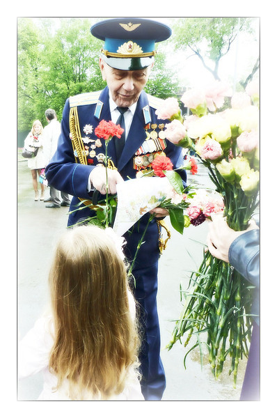 Flowers from an angel. (5.27.2012)<br /> <br /> From the May 9th Victory Day holiday. This man was a B-25 Mitchell mid-range bomber pilot.