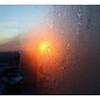 Sunset through the hotel's frosty window
