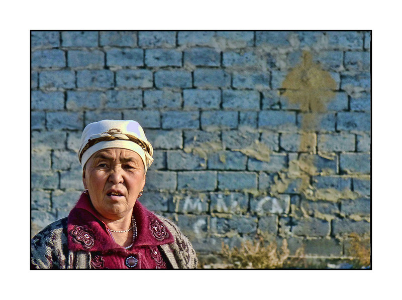 Migrant worker in front of housing she & others are building on the outskirts of Bishkek, Kyrgyzstan. (2.4.2012)