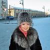 Layla Tukhtabaeva dressed against the cold. (11.27.2011)