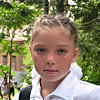 Freckle faced school girl. <br /> <br /> School's out for summer as of yesterday. Uniforms are quite common in Russian schools. Bows for the girls & sport coats for the boys are de rigueur especially on the first & last days of school, as are flowers for the teacher.  (5.28.2011)