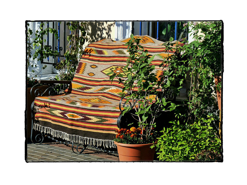 Bench with serape. (6.18.2012)<br /> <br /> This bench was outside a Ukrainian restaurant where a friend of ours celebrated her birthday yesterday. It was a very busy weekend with no time to post. Hope everyone had an enjoyable Father's Day.