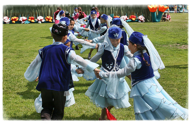 Tatar children dancing at their national festival known as Sabantuy in the town of Arsk. (Tatarstan, Russia). (6.13.2012)<br /> <br /> The festival of Sabantuy is currently a candidate for UNESCO's List of Masterpieces of the Oral and Intangible Heritage of Humanity.