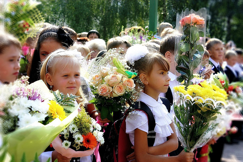 It's September 1st & throughout Russia & the former USSR, it's the first day of school. It's expected that everyone dress up and bring flowers for their teacher. We have a school behind our apartment building so I stepped out to catch some of the morning's activities. (9.1.2011)