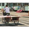 Transporting a sheet of drywall in Heihe, China. ( (Хейхе, Китай) (7.16.2011)