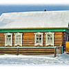 A typical Russian village home with traditional hand carved window frames. This one's in good condition. Many of them are totally cock-eyed as they're built without foundations & shift when the earth freezes. Insulation between those unfinished wooden planks? Horse hair! (2.25.2012)<br /> <br /> Edit: Rustem tells me they use flax, not horse hair... all about the same to me. <br /> <br /> Thanks for all your wonderful comments yesterday! Have a good weekend.