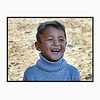 Laughing Kyrgyz boy in a blue sweater. (2.5.2012)