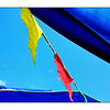 Flags against umbrellas & sky. (6.4.2012)