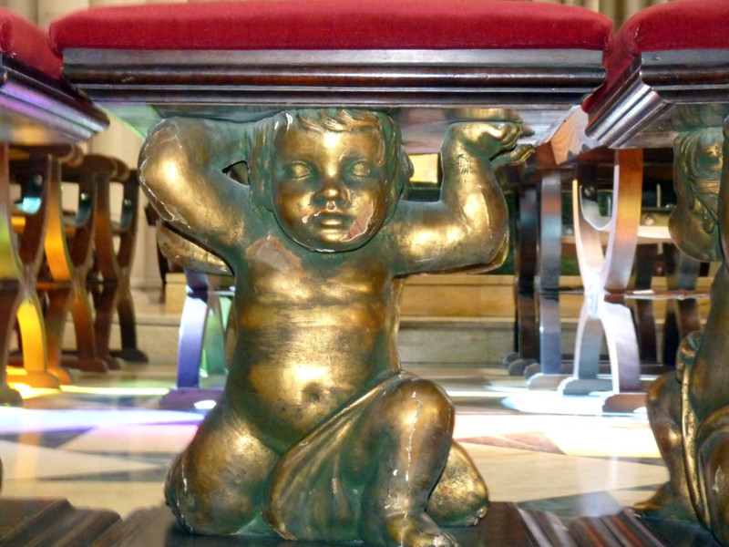 Cherub stool in Madrid's Cathedral de Santa María la Real de la Almudena. (9.27.2011)<br /> <br /> Missing our Daily community, but too busy and/or tired to actively participate. Greetings to all!