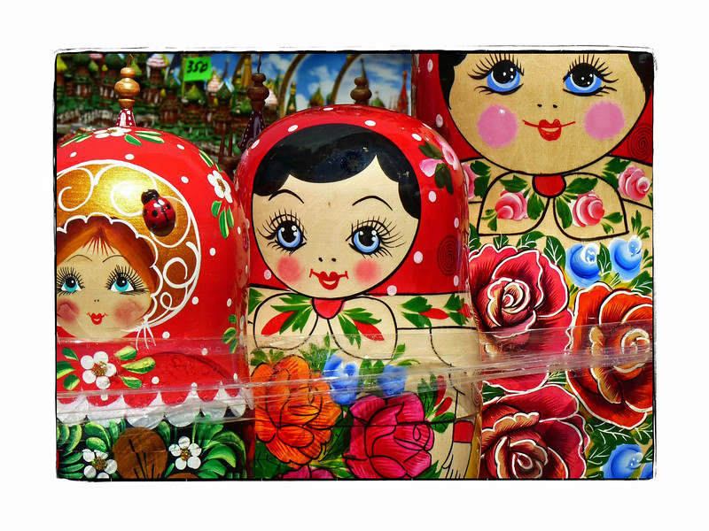 Traditional Matryoshka dolls. (6.29.2012)<br /> <br /> An always popular souvenir from Russia, these nesting dolls can be quite elaborate with as many as 20 smaller dolls inside, each painted somewhat differently.  My mother bought a beautiful set when she visited with each doll portraying a different fairy tale. These pictured are fairly standard & probably have 4-6 smaller dolls inside.They can get quite expensive depending on the number of dolls contained within & how elaborate the painting is. The tradition dates from 1890.