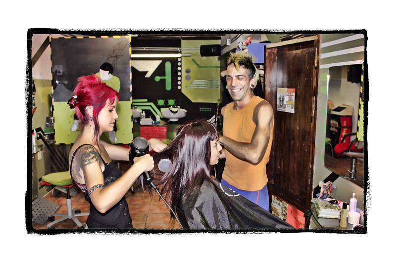 Hair style is the final tip-off whether or not a woman really knows herself.  ~Hubert de Givenchy, Vogue, July 1985 (10.8.2011)<br /> <br /> We passed by this salon in the hip neighborhood of Barrio del Carmen in Valencia, Spain and saw this young woman having her hair worked on by two stylists. Couldn't resist a shot. <br /> <br /> Yes, we're back in Moscow and just in time to enjoy what's said to be the last nice day of the season. Lots of catching up to do, including with all of you. Enjoy your weekend.