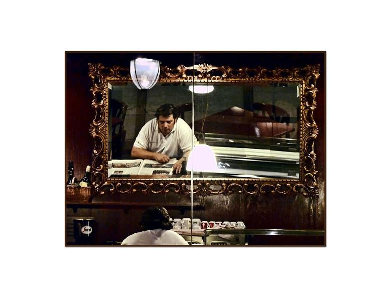 Bar man reading newspaper. (1.12.2012)