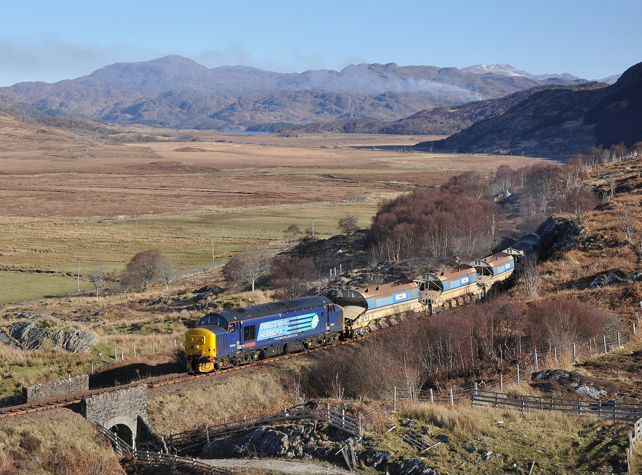 37419 passes Kinloid on 26/02/13 with a ballast from Mallaig - Fort William.<br /> Published in West Highland News Summer 2013.