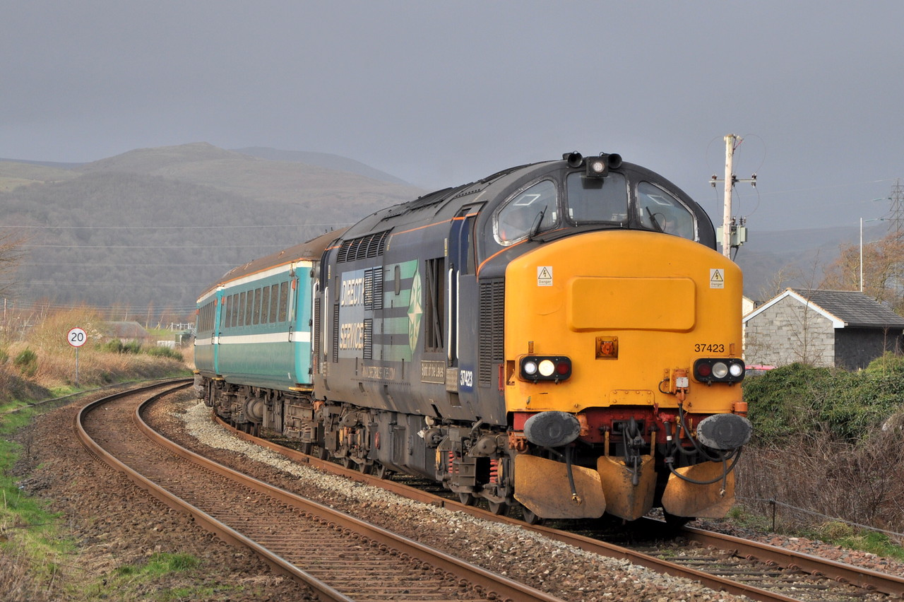 37423 passes Foxfield with the Carlisle - Barrow 'Sellafield Flyer' test run on 28/12/11.<br /> Published in Railways Illustrated March 2012.