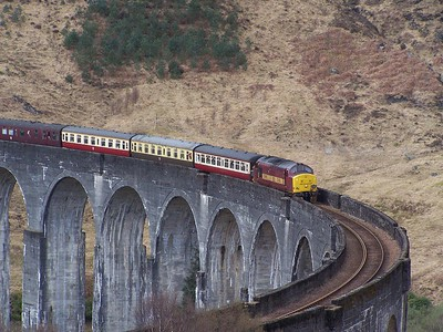 37401 crosses Glenfinnan Viaduct on 11/04/09 with a charter from Mallaig - Fort William. Published in West Highland News Summer 2009.