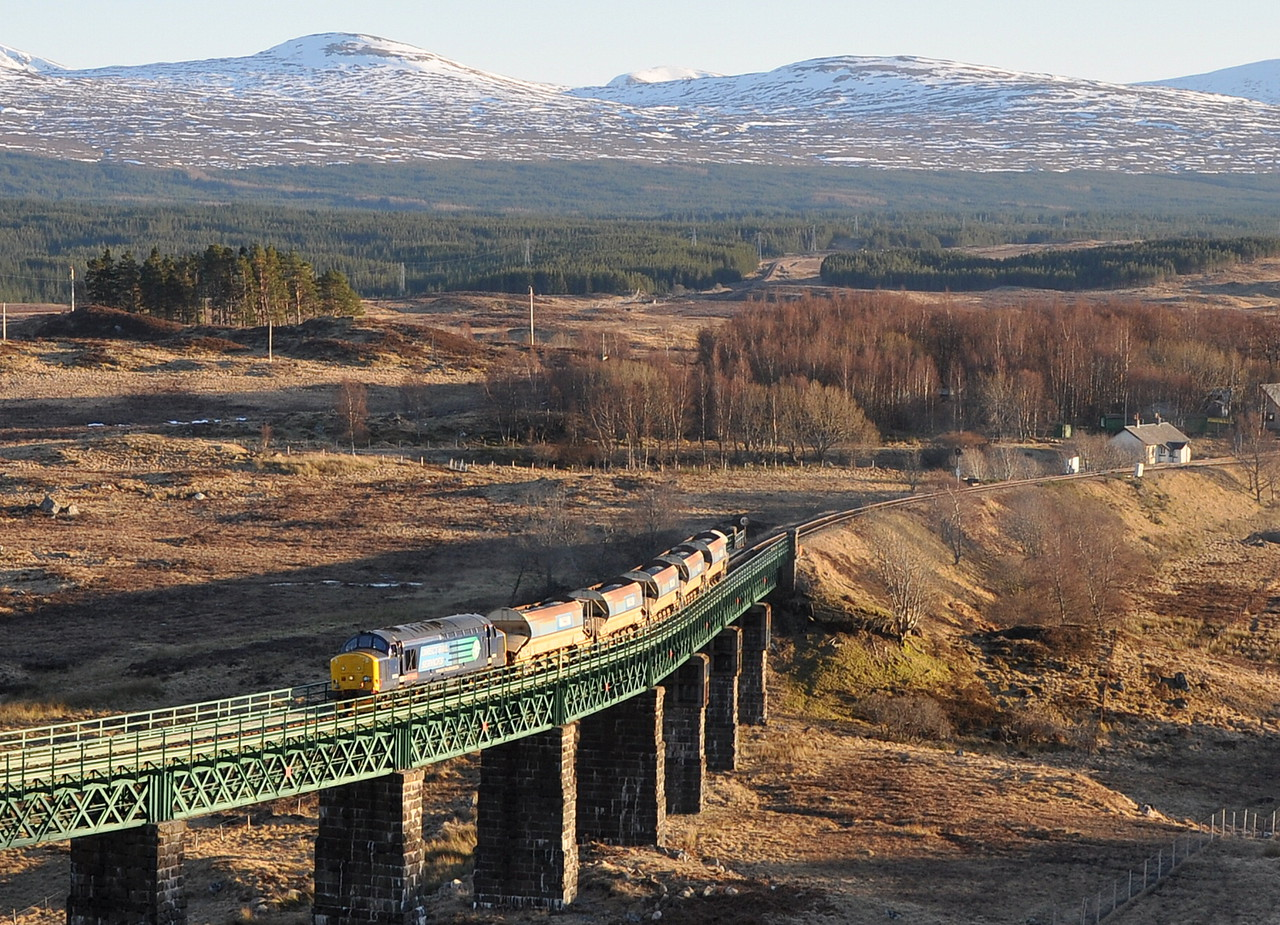 37419 crosses Rannoch Viaduct on 25/02/13 with a ballast from Mossend - Fort William.<br /> Published in Railways Illustrated May 2013.