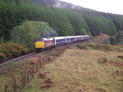 37406 climbs County March Summit with the London - Fort William Caledonian Sleeper during April 2006. Published in West Highland News Autumn/Winter 2008.