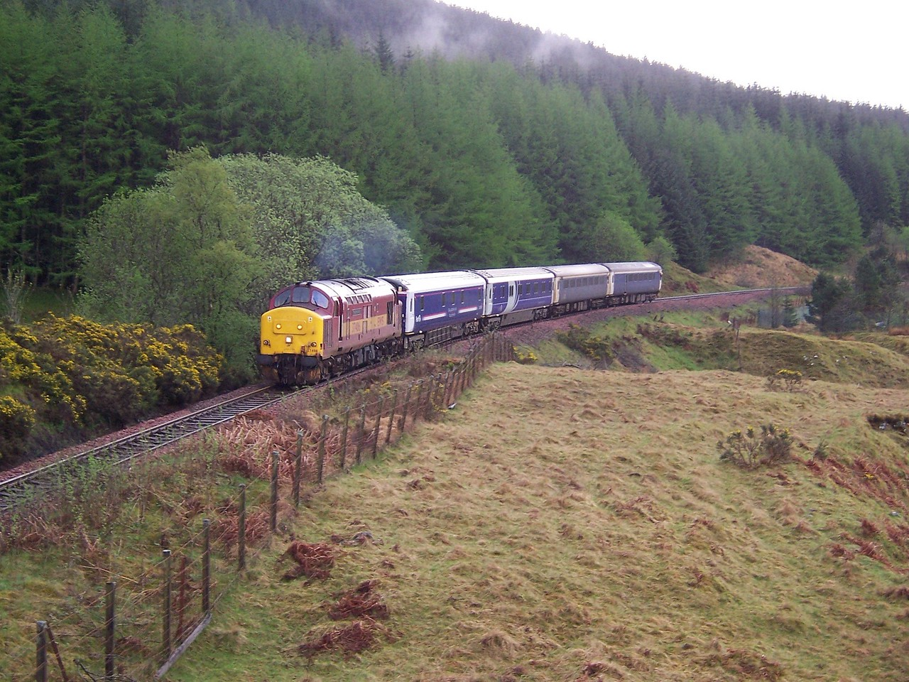 37406 climbs County March Summit with the London - Fort William Caledonian Sleeper during April 2006.<br /> Published in West Highland News Autumn/Winter 2008.