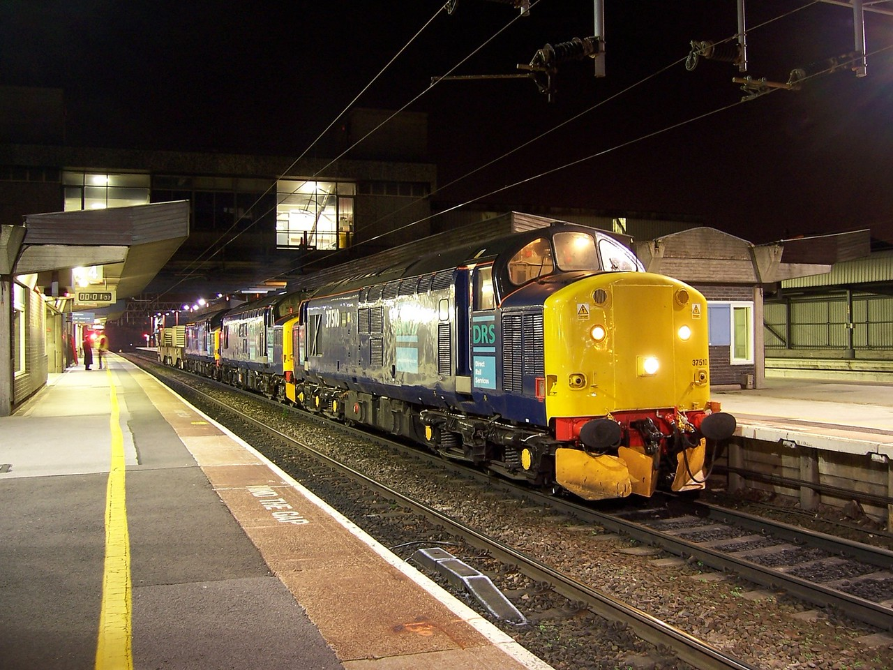 37510, 37194 and 37038 stand at Stafford with the Willesden - Crewe nuclear flasks on 01/11/06.<br /> Published in Rail Express December 2006.
