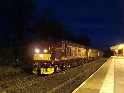 37676 stands at Hellifield on 12/11/08 with 47245, 57601 and 47851 during a test run from Carnforth - Carnforth. Published in Railways Illustrated January 2009.