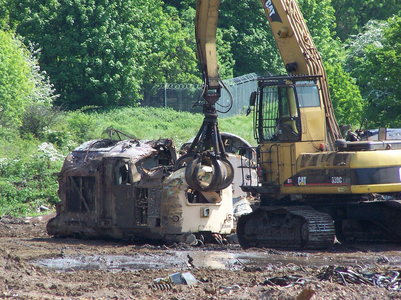 The sorry remains of 37694 get dragged about at Kingsbury on 13/05/08.<br /> Published in Railways Illustrated July 2008.