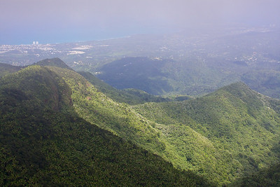 From the top of Mount El Yunque, about a 5 mile hike round trip from the trailhead. In the distance you can see the town of the Luquillo to the left. And in the upper right you can see the town of Fajardo. So from here you can see the whole north eastern corner of Puerto Rico.